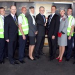 Andrew Harrison, Manchester Airport Managing Director and Jeff Wilkinson, Etihad Airways Vice President for Maintenance, surrounded by Etihad Airways technical staff.